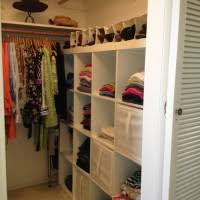 white wooden for small closet with cube shelves and clothes hanging with lighting as best lighting for closets