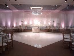 ivory head table backdrop with blush pink uplighting beautiful color table uplighting