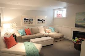 cream couch living room ideas: furniture alluring basement living rooms decor ideas with l shape cream sofa and white lounge sofa grey covered floor also drum shape table lamp plus