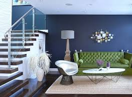 bold green sofa along with the timeless platner armchair in the living room design bold living room furniture
