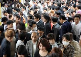 population woes crowd the times commuters make their way slowly through a crowded train station in tokyo in 2011