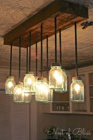 decorating with mason jars lots of creative ideas and tutorials including this diy mason beautiful funky dining room lights