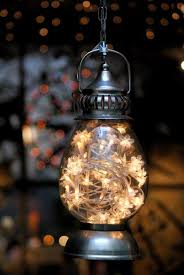 diy idea hang a lantern filled with a strand of twinkle lights great for halloween christmas this is beautiful but the evil kids in our beautiful lighting fixtures