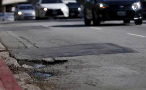 Image result for bad street pavement conditions picture