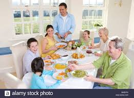 Family Dining Room Multi Generation Family Eating Dinner At Dining Room Table Stock