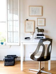 interior chic typewriter on wooden floor under glass window side beautiful picture on cute frame chic small white home