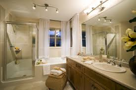 corner shower room design in cool bathroom feat oval undermount sink with ample vanity unit and ample shower lighting