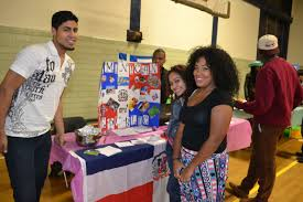 cultures collide photos the beacon mcla from left senior david camillo freshman elizabeth diaz and senior dary burgos learn about the n republic at the all around the world event last