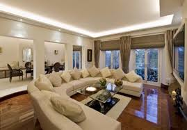 beige striped wool area rugs brown finish oak coffee table large living rooms fireplace black leather awesome large living room