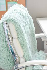 mint blanket on white office chair for home office chic mint teal office
