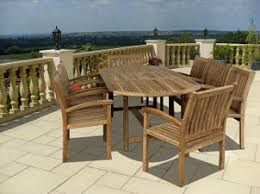 patio dining: wooden patio dining set dresses up tropical patio