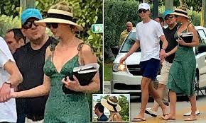 Ivanka Trump wears a <b>summer dress</b> and a bizarre full straw visor ...