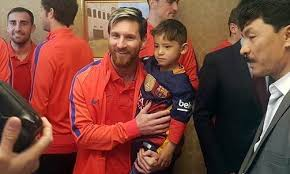 Image result for Messi meets Afghan boy who made football shirt out of plastic bag