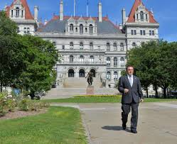corruption museum s cup runneth over times union st rose professor bruce roter outside the state capitol in albany ny wednesday