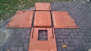 DIY Slanted Roof Dog HouseDog house components laid out flat
