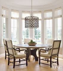 a pendant by ironies hangs above a gregorius pineo table which anchors the sunny breakfast nook the armchairs are from formations see more breakfast nook lighting