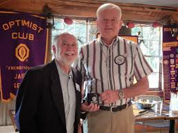 optimist club of jasper first meeting of the new club year bob anderson receiving thanks from larry starr club president