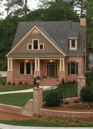 Selecting Home Fencing   House Plans and MoreCraftsman style house plan   stylish brick and wrought iron fence