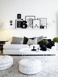 using black and white photos living room wall decor including small plants coffee table centerpiece and furry light gray rug in living room image black white rug home