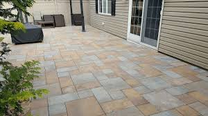 stone patio installation: backyard patio installation massapequa long island ny using two different color pavers for patio