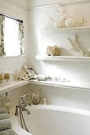 image bathtub decor: shelves line walls around bathtub in bathroom with seaside beach cottage theme shells sponges seashell home decor diy repurpose salvage recycle