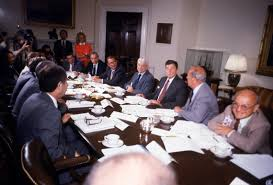 milton friedman ph d academy of achievement 1981 milton friedman george shultz president ronald reagan arthur burns william simon and walter wriston at house economy meeting advisors