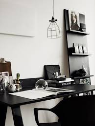 a simple scheme of blackwhite gives a neat and tidy vibe to this office black and white office