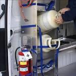 Refrigerant tank racks for trucks