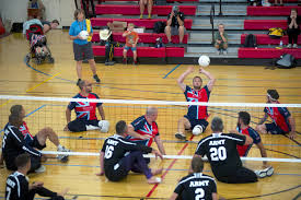 u s department of defense photo essay a british athlete hits the ball during a sitting volleyball match between the u s army and