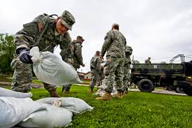 u s department of defense photo essay na national guard u s army pvt ricardo torres lays sandbags to help prevent flooding in