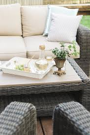 a little greenery decorates the coffe table from brown jordan northshore patio furniture collection brown jordan northshore patio furniture