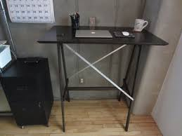 black stained wooden reverse knife edge profile top stand desk with black iron legs and u captivating shaped white home office furniture