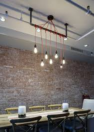 room light fixture interior design:  simplicity of the lighting makes a bold statement in the industrial dining room design