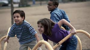 Afterschool Programs and Homework Help  What to Look For Three children on a merry go round at a playground  Can Afterschool Programs Help