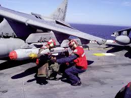 us marine corps job field ordnance navy and marine corps aviation ordnancemen load ordnance onto an av 8b harrier aboard the landing