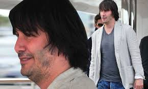 Keanu Reeves is almost unrecognisable as he packs a paunch ...
