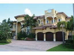 Cocoa Beach Mediterranean Home Plan S    House Plans and MoreMediterranean Stucco Home With Clay Tile Roof