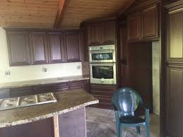 but kitchen cabinet under lighting it would be easy enough to wire and would help make the granite pop dont want it to look cheesy though cabinet under lighting