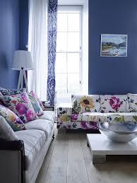 dark blue living room with modern flowers sofa blue dark trendy living room