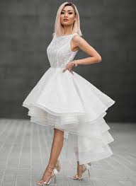 avant garde outfit with clutch avant garde white ruffled dress with winged sandals avant garde