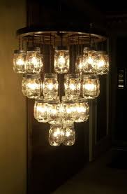 1000 ideas about wagon wheel chandelier on pinterest wheel chandelier wagon wheel light and chandeliers alternating length wagon wheel mason jar
