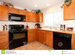 images kitchen cabinets pinterest traditional traditional medium wood cherry kitchen cabinets with black appliances