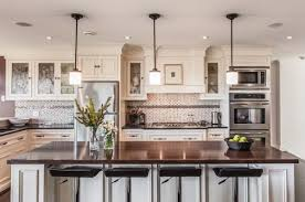 View In Gallery Dazzling Pendant Lights Above A White Kitchen Island With Dark Granite Top  Decoist