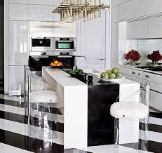 white decor reflective surfaces and a bold graphic print black and white wall paper is all you need to turn your home office into a luxurious space like black and white home office