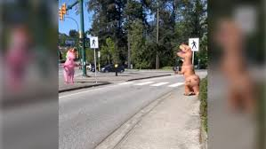 <b>T</b>-<b>rex</b> and <b>unicorn</b> meet on a Coquitlam traffic island. Hilarity ensues ...