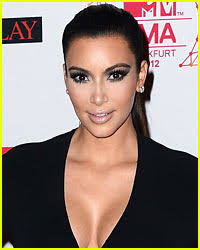 Kim Kardashian glammed up last night as the date of Sgt. Martin Gardiner for the annual Marine Corps Ball – TMZ; Does Kristen Stewart still feel guilty ... - kim-kardashian-attends-marine-corps-ball