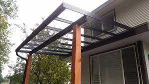 aluminium patio cover surrey: coquitlam glass patio cover black aluminium frame with wood posts