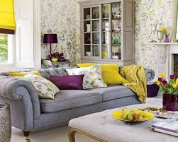 Yellow Living Room Decorating Living Room White Shelves Gray Recliners Gray Sofa Brown Chairs