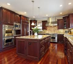 fancy varnished dark walnut wood affordable kitchen cabinets placed on the glossy wooden floor the affordable kitchen furniture