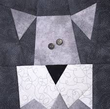 cats n dogs paper pieced quilt made by marney here s my neighbor s schnauzer he walks this dog every morning and he my neighbor not the dog is always carrying a cup of coffee as he walks